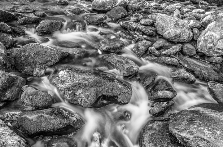 Black and White Photography of a River and Rocks